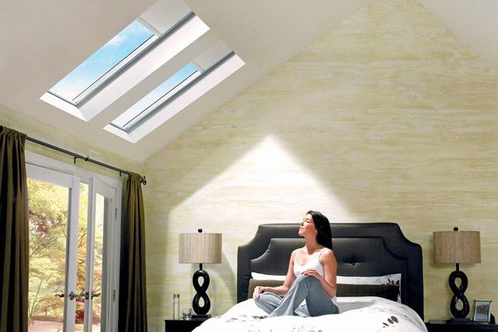 A woman enjoying the benefits of a skylight